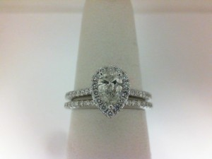 White 14 Karat Wedding Band With 21=0.18Tw Round Diamonds