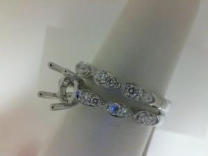 White 14 Karat Bridal Set Ring Size 6 With 12=0.23Tw Round Diamonds And 12=0.22Tw Round Diamonds Serial #: 17941
