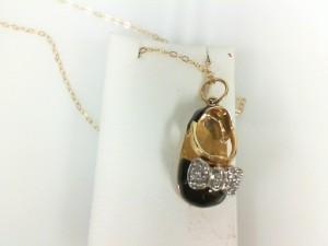 Yellow 14 Karat Pendant With 0.12Tw Round Diamonds Name: Baby Bootie W/Diamond Bow Chain: Cable Link Metal: 14 Karat Color: Yellow