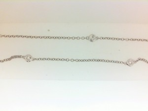 White 14 Karat Bezel Set Necklace With 6=0.14Tw Round Diamonds Name: Diamonds By The Yard Metal: 14 Karat Color: White Length: 16