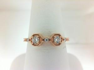 Forevermark:18 Karat Rose Gold Tribute Ring With One 0.08Ct Forevermark Round H Si1-2 Diamond, One 0.08Ct Forevermark Round H Si1-2 Diamond And .03 Non Forevermark Diamonds Fm 8771508 Fm7009592