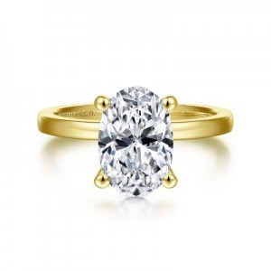 14 Karat Yellow Gold Solitaire Ring Size 6.5 Center Size: Oval10.5X7mm