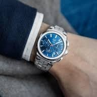 Tag Heuer: Stainless Steel 41mm Link Automatic Chronograph Watch Name: Sapphire Crystal With Anti-Reflective Treatment Name Of Bracelet: Link Clasp: Deployment Finish: Satin And Polish Dial Color: Blue Sunray Brushed Dial Bezel: Steel Alternate Fini
