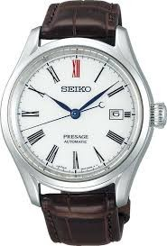 Seiko Luxe:Presage Stainless Steel Automatic Watch Caliber Number 6R35 Dual-Curved Sapphire Anti-Reflective Coating On Inner Surface Name Of Bracelet: Crocodile Leather Clasp: Deployment Buckle Finish: Satin And Polish Dial Color: Arita Porcelain Be