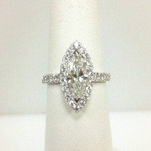White 14 Karat Engagement Ring Size 6.5 With One 0.76Ct Marquise Diamond Si-2/H-I And 34=0.42Tw Round Diamonds Serial #: 706927
