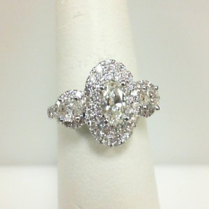 White 14 Karat Engagement Ring One 0.33Ct Oval Diamond Si-2/H 2=0.33Tw Marquise Diamonds 68=0.46Tw Round Diamonds Serial #: 699027