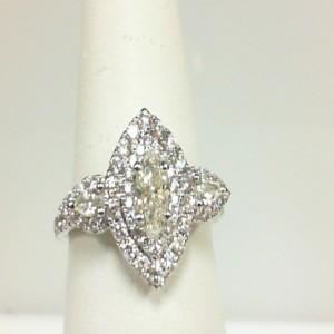 White 14 Karat Engagement Ring One 0.35Ct Marquise Diamond Si-2/J-K 2=0.14Tw Pear Diamonds 70=0.54Tw Round Diamonds Serial #: 697927