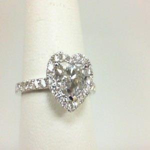 White 14 Karat Engagement Ring Size 6.5 With One 0.97Ct Heart Diamond I-1/J-K And 34=0.48Tw Round Diamonds Serial #: 707123