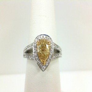 Yellow/White 18 Karat Ring With One 1.04Ct Pear Fancy Yellow Si1 Diamond And 57=0.29Tw Round Diamonds Name: Gia Serial #: 571972