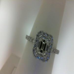 White 14 Karat Ring With 28=0.53Tw Round Diamonds And One 0.70Ct Emerald J I1 Diamond