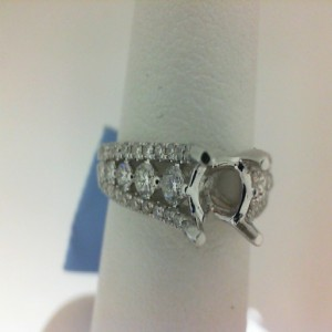 White 14 Karat Set Size 6.5 With 54=0.72Tw Round Diamonds Serial #: 551459 Center Size: .75