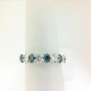 White 14 Karat Wedding Band With 9=0.68Tw Round Diamonds