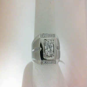 White 14 Karat Gents Fashion Ring With One 0.62Ct Round I Si3 Diamond And 26=0.18Tw Round Diamonds