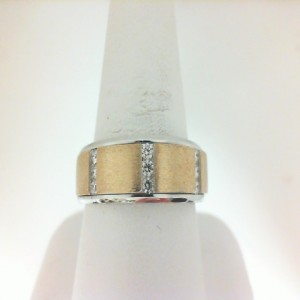 Two-Tone 14 Karat  Ring With 9=0.25Tw Round H Si1-2 Diamonds