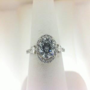 White 18 Karat Ring Size 6.5 With 52=0.29Tw Round Diamonds And 2=0.14Tw Pear Diamonds Serial #: 524806
