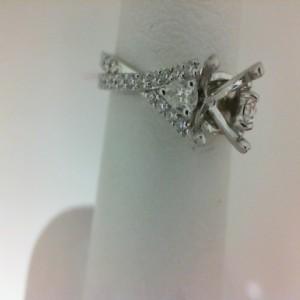 White 18 Karat Twist Ring Size 6.5 With 36=0.33Tw Round Diamonds And 2=0.18Tw Pear Diamonds Center Size: 1Ct Serial #: 557848