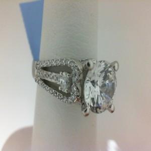 White 18 Karat Ring Size 6.5 With 76=0.43Tw Round Diamonds And 2=0.14Tw Oval Diamonds Center Size: 3Ct Serial #: 364580