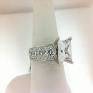 White 14 Karat Ring With 94=0.65Tw Round Diamonds And 12=0.43Tw Princess Diamonds