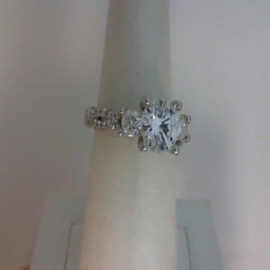 White 18 Karat Ring  With 64=0.80Tw Round Diamonds  Center Size 6.8mm