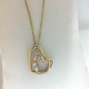 Yellow 14 Karat Heart Pendant With 2=0.06Tw Round Diamonds Metal: 14 Karat Length: 18