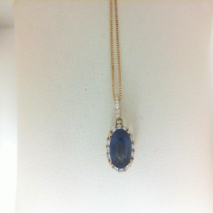 Yellow 14 Karat Pendant With 22=0.20Tw Round Diamonds And One 1.53Ct Oval Sapphire On 18 Box Chain