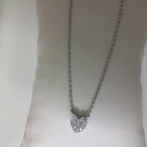 White 18 Karat Heart Necklace With 7=0.10Tw Round Diamonds And One 0.05Ct Round Diamond Length: 18