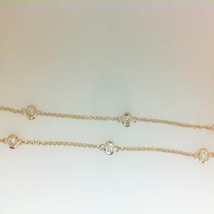 Yellow 14 Karat Bezel Set Necklace With 10=0.51Tw Round Diamonds Name: Diamonds By The Yard Metal: 14 Karat Color: Yellow Length: 16 18