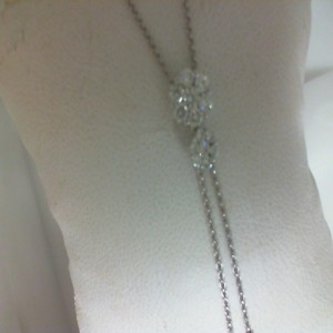 White 14 Karat Necklace With 30=0.63Tw Round Diamonds Name: Flower Lariat Length: 16/18