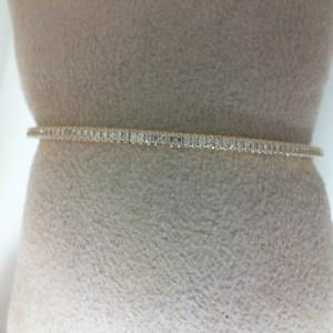 Yellow 14 Karat Bangle Bracelet With 75=0.38Tw Round Diamonds
