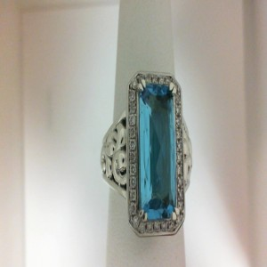 Sterling Silver Fashion Ring With One 15.00X7.00Mm Emerald Cut Swiss Blue Topaz And 34=0.34Tw Round Diamonds