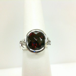 Sterling Silver Fashion Ring With One 10.00X8.00Mm Oval Garnet And 2=1.70Mm Round Rubys Ring Size: 6.5