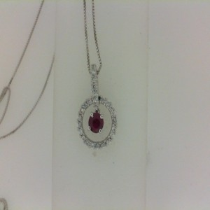 Lady S White 18 Karat Pendants With One 0.31Ct Round Ruby And 25=0.22Tw Round Diamonds