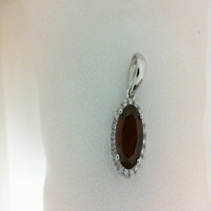 White 14 Karat Pendant With 20=0.13Tw Round Diamonds And One 1.84Ct Oval Garnet