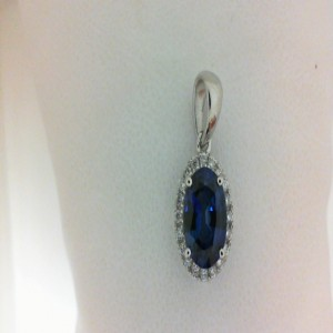 White 14 Karat Pendant With 20=0.13Tw Round Diamonds And One 1.51Ct Oval Created Sapphire