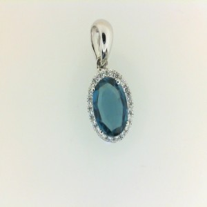 White 14 Karat Pendant With 20=0.13Tw Round Diamonds And One 1.22Ct Oval Blue Topaz