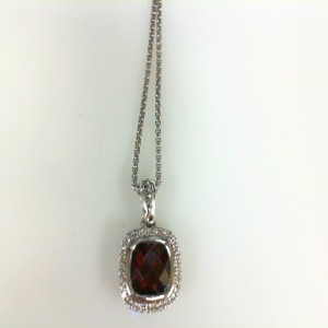 Sterling Silver Pendant With One 7.00X7.00Mm Cushion Cut Garnet And 32=0.13Tw Round Diamonds Style: Round Box Metal: Sterling Silver Length: 17