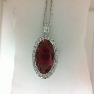 White 18 Karat Pendant With 55=0.91Tw Round Diamonds And One 5.28Ct Oval Pink Tourmaline