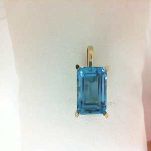 Yellow 14 Karat Pendant With One 7.20Ct Emerald Cut Blue Topaz