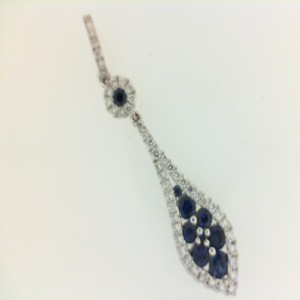 White 18 Karat Pendant With 0.25Tw Round Diamonds And 9=0.47Tw Round Sapphires Style: Box Metal: 14 Karat Color: White