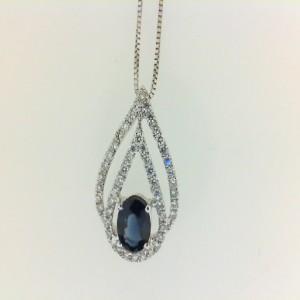 White 14 Karat Pendant With 0.23Tw Round Diamonds And One 0.44Ct Round Sapphire Style: Box Metal: 14 Karat Color: White Length: 18