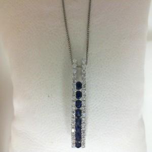 White 14 Karat Pendant With 8=0.41Tw Round Sapphires And 36=0.30Tw Round Diamonds Style: Box Metal: 14 Karat Color: White Length: 18