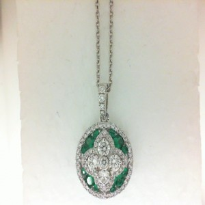 White 18 Karat Circle Pendant With 81=0.90Tw Round Diamonds And 12=0.40Tw Round Emeralds Length: 17 inch