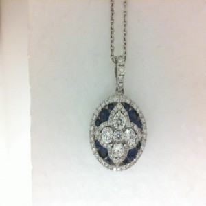 White 18 Karat Circle Pendant With 81=0.86Tw Round Diamonds And 12=0.55Tw Round Sapphires Length: 17