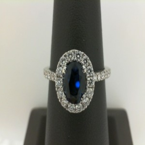 White 14 Karat Ring 1.03 Oval Cut Sapphire 1.03 Cts And 30=0.49Tw Round Diamonds