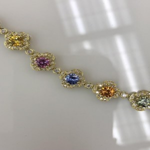 Yellow 18 Karat Bracelet With 14=7.83Tw Round colored Sapphires And 238=1.45Tw Round Diamonds