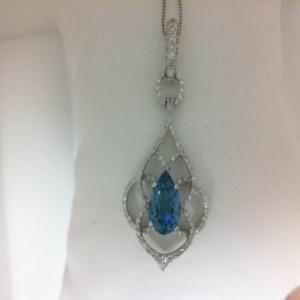 White 18 Karat Pendant With 128=0.47Tw Round Diamonds And 1.59Tw Pear London Blue Topazs