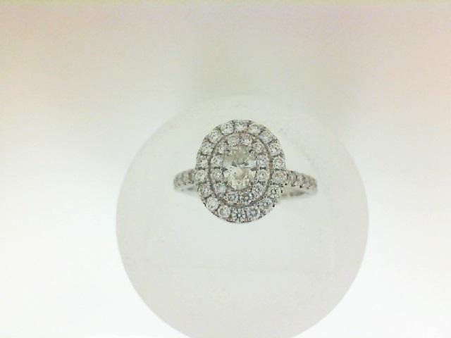 14 Karat White Gold Ring With One 0.31ct Oval I/J I1 Diamond And 44=0.70tw Round Diamonds
