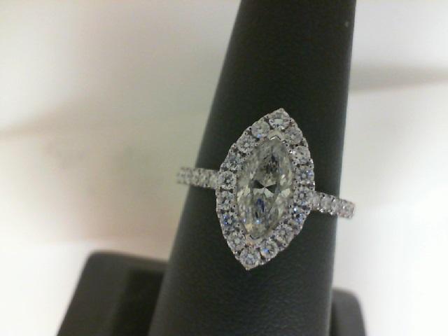 14 Karat White Gold Ring  With One 0.74Ct Marquise K Si2 Diamond And 34=0.48Tw Round Diamonds