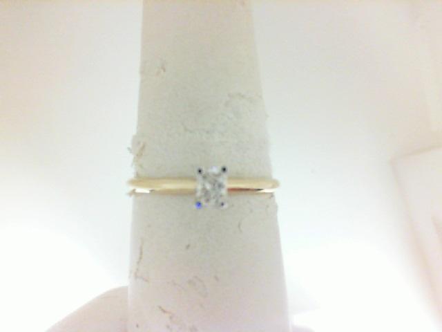 14 Karat Yellow  Gold Solitiare Ring With One 0.19 Ct Radiant G/H Vs1-2 Diamond