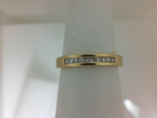 14 Karat Yellow Gold Channel Set Wedding Band With 10=0.20Tw Princess Cut Diamonds